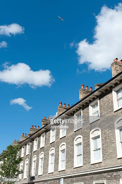 London terraced houses with aeroplane