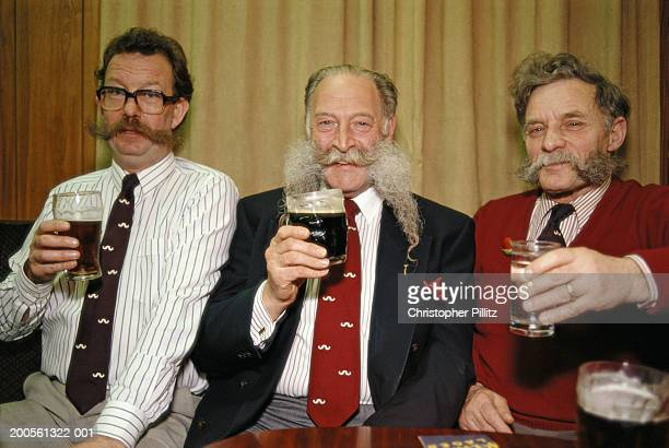 London, The Handlebar Moustache Club members raising toast.