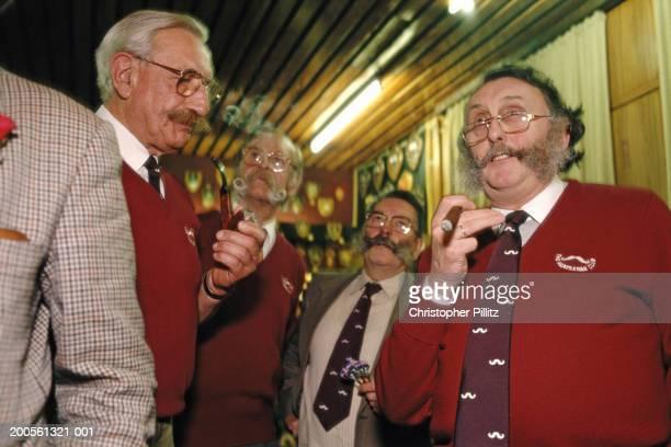 London, The Handlebar Moustache Club members talking.