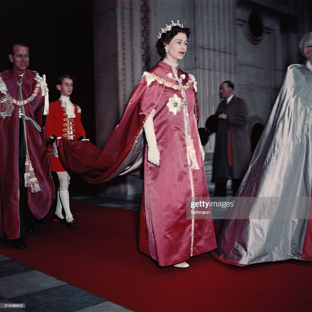 Queen Elizabeth II Escorted in Her Royal Attire : News Photo
