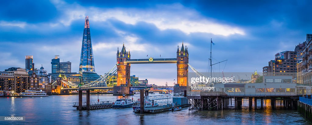 London Tower Bridge and The Shard illuminated over Thames panorama : Stock Photo