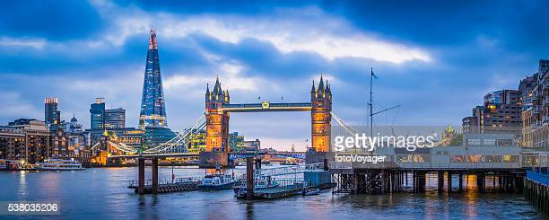 london tower bridge and the shard illuminated over thames panorama - river thames stock pictures, royalty-free photos & images