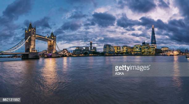 london tower bridge and the shard illuminated over thames panorama - local government building stock pictures, royalty-free photos & images