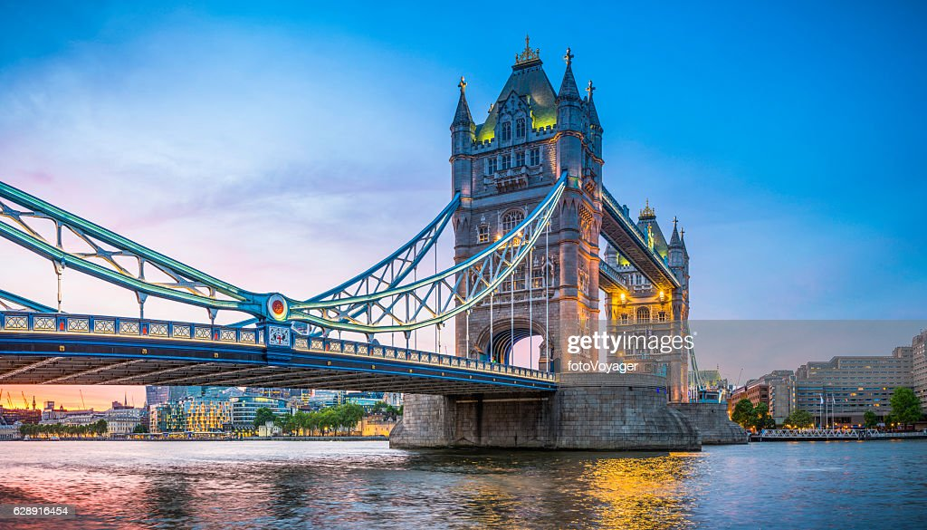 London Tower Bridge illuminated at sunset over River Thames panorama : Stock Photo