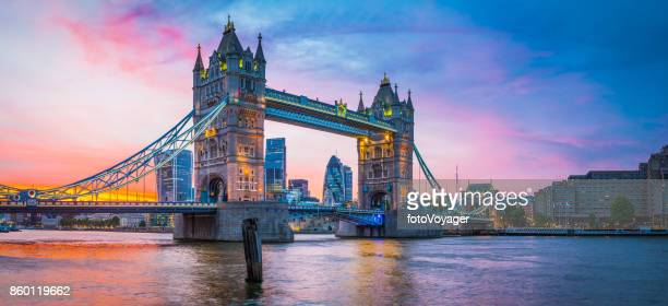 london tower bridge river thames city skyscrapers illuminated sunset panorama - london bridge stock photos and pictures