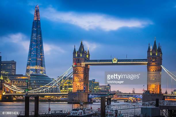 London Tower Bridge River Thames waterfront illuminated at sunset UK