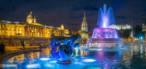 london trafalgar square fountains illuminated at night panorama uk - national portrait gallery london stock pictures, royalty-free photos & images