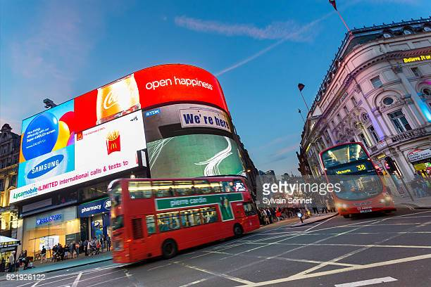 london traffic in piccadilly circus - piccadilly stock pictures, royalty-free photos & images