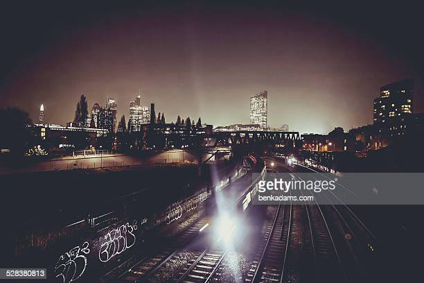 london train at night - east london stock pictures, royalty-free photos & images