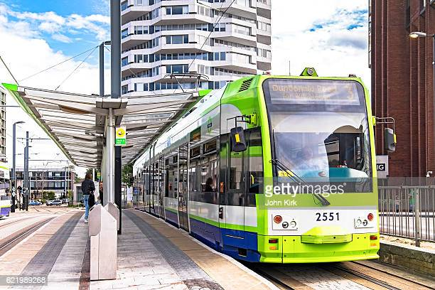 london tramlink tram 2551 departing croydon stop - tram stock photos and pictures