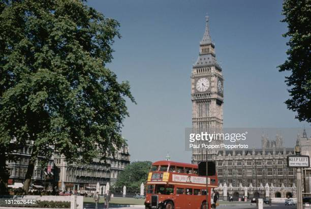 London Transport number 3 double decker RT bus bound for Camden Town drives around Parliament Square with the Clock Tower , Big Ben and the Houses of...