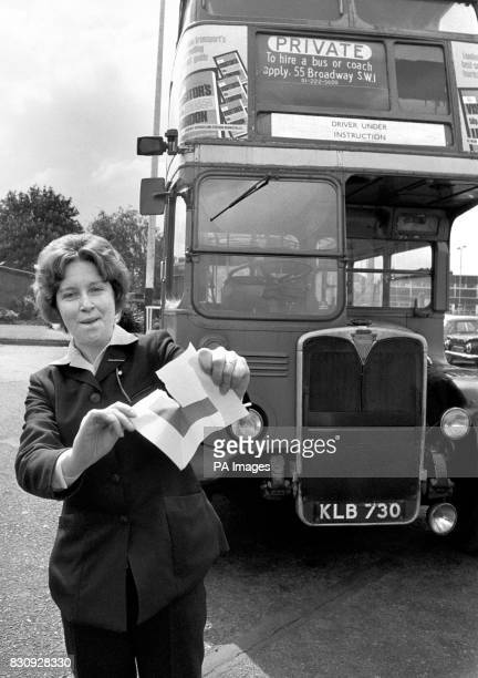 London Transports first woman bus driver Mrs Rosamund Viner who passed her driving test with flying colours tears up her Lplates at the driver...