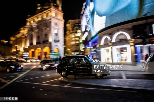 A London typical taxi is seen in Piccadilly Circus London United Kingdom on May 5 2019