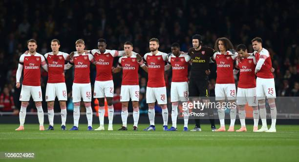 London UK 31 October 2018 Arsenal players observe a minutes silence for The Leicester owner Vichai Srivaddhanaprabha LR Aaron Ramsey Stephan...