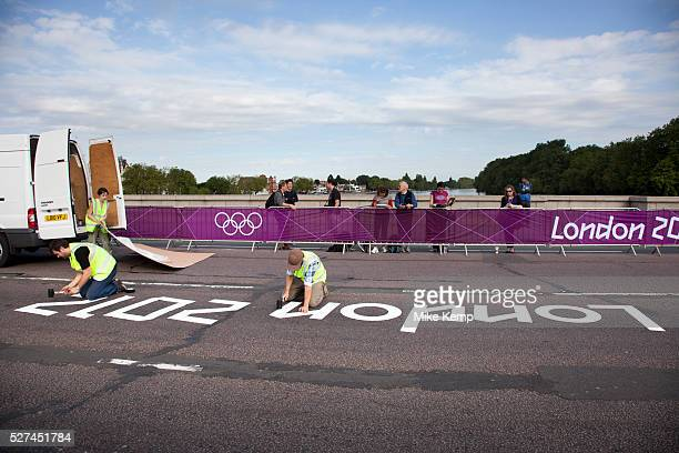 London UK Saturday 28th July 2012 On Putney Bridge in London staff install a London 2012 logo onto the road prior to the Men's Team Road Race