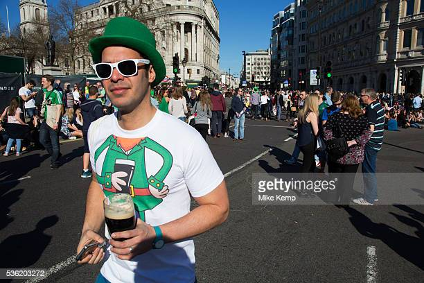 London UK Sunday 16th March 2014 Revellers gather in central London for the annual St Patrick's Day celebrations Saint Patrick's Day or the Feast of...