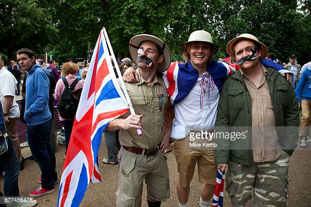 London UK Tuesday 7th August 2012 Men's Triathlon held in Hyde Park Team GB fans dressed in colonial outfits with pith helmets and khaki clothes