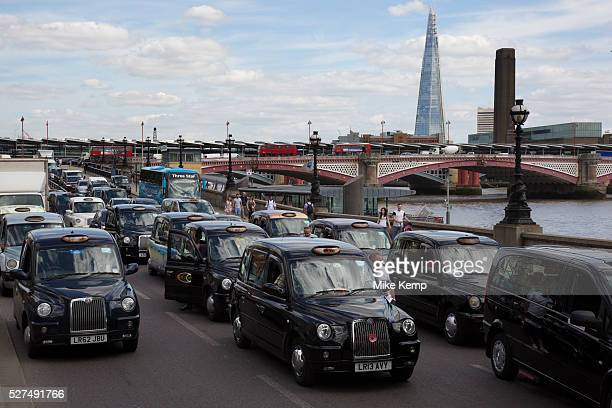 London UK Wednesday 11th June 2014 Black taxi drivers protest against taxi service app Uber brings central London to a standstill on Victoria...