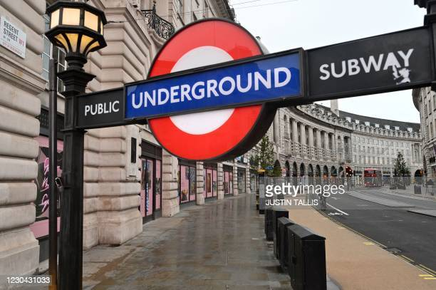 London Underground entrance is pictured on an almost deserted Regent Street in London on January 5 as Britain entered a national lockdown to combat...