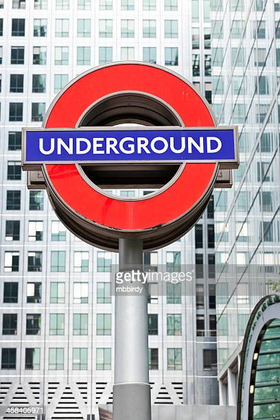 london underground famous sign in canary wharf - underground sign stock pictures, royalty-free photos & images