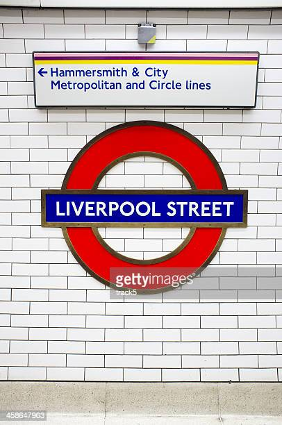 london underground: liverpool street tube station roundel - underground sign stock pictures, royalty-free photos & images