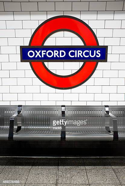 london underground: oxford circus tube station roundel - roundel stock pictures, royalty-free photos & images