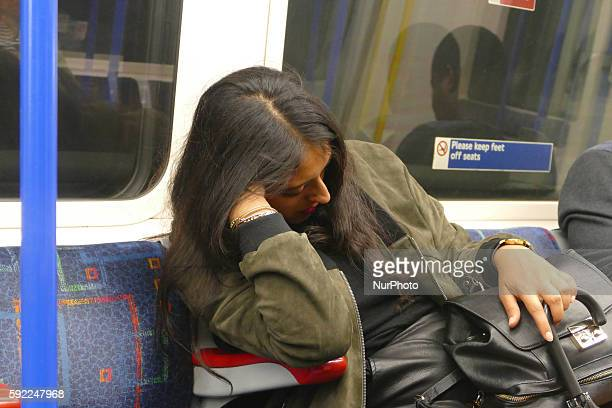 London Underground passenger travels on Victoria line in London England on August 19 2016 The London underground has just launched a new 24 hour...