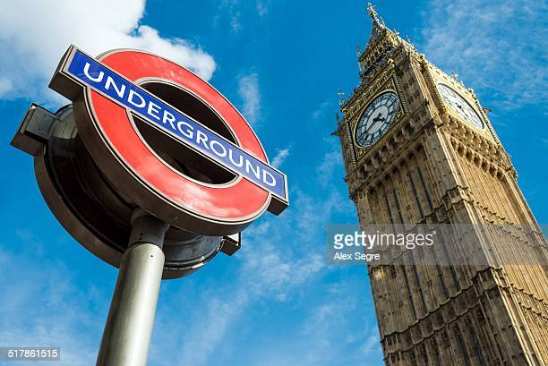 London Underground sign and Big Ben Westminster London UK