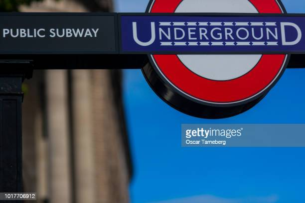 London Underground sign - blue sky
