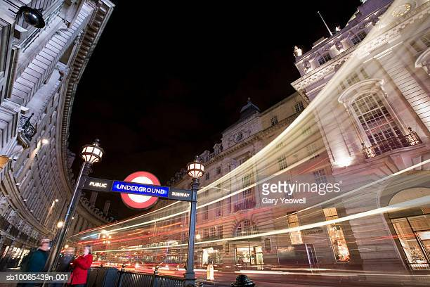 uk, london, underground sign in piccadilly circus at night (wide-angle lens) - building entrance stock pictures, royalty-free photos & images
