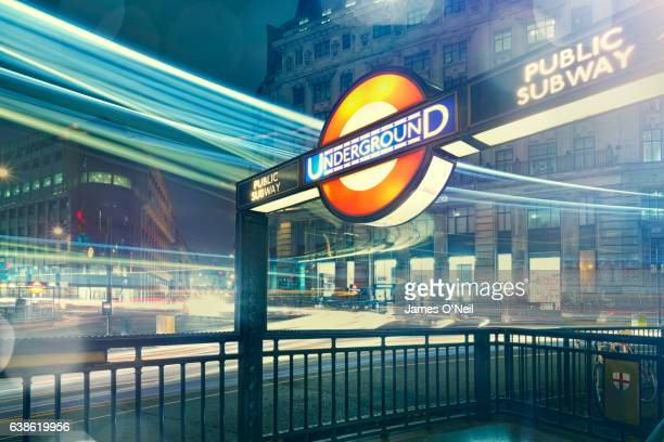 London Underground Station at night with light streaks