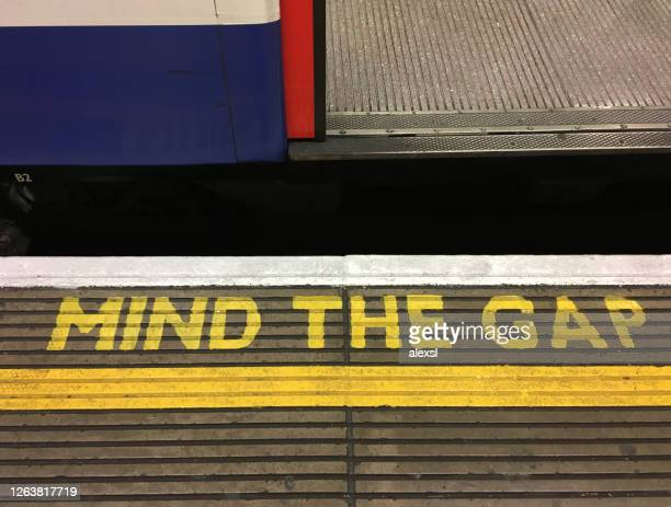 london underground station mind the gap warning sign - separation stock pictures, royalty-free photos & images
