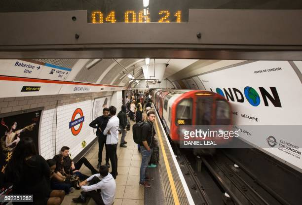 A London Underground train arrives at Oxford Circus station in central London on August 20 following the launch of the 24 hour night tube service The...