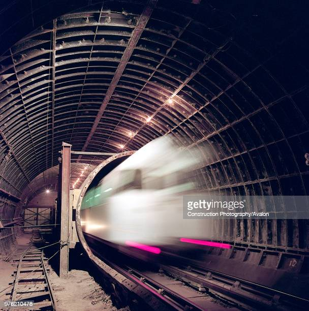 London Underground train entering tunnel during refurbishment of Angel Underground station London United Kingdom