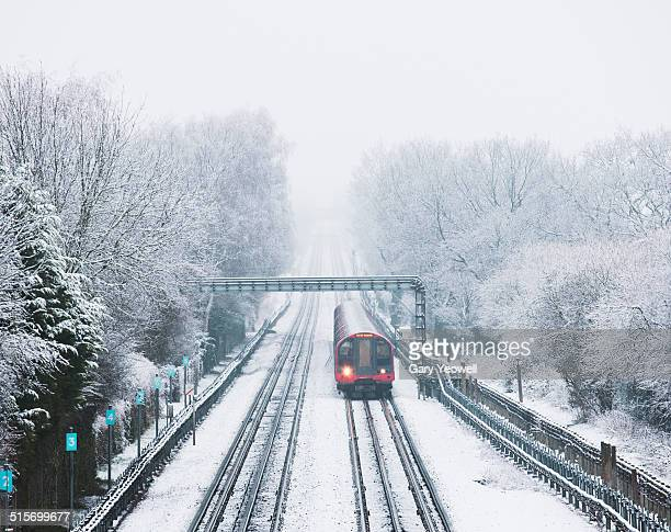 London Underground train on snow covered lines
