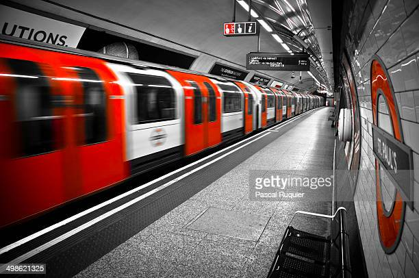 CONTENT] London Underground Tube train leaving the deserted station of ST PAUL'S