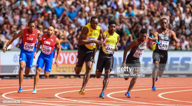 London United Kingdom 12 August 2017 Usain Bolt receives the baton from his Jamaica teammate Micheal Campbell in round one of the Men's 4x100m Relay...