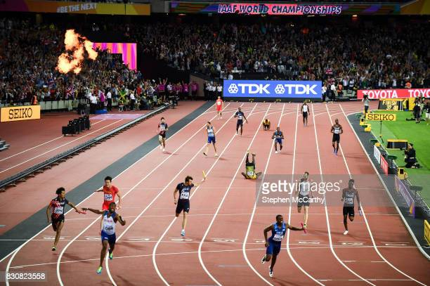 London United Kingdom 12 August 2017 Usain Bolt running the anchor leg for his Jamaica team falls on the track as Great Britain win the Men's 4x100m...