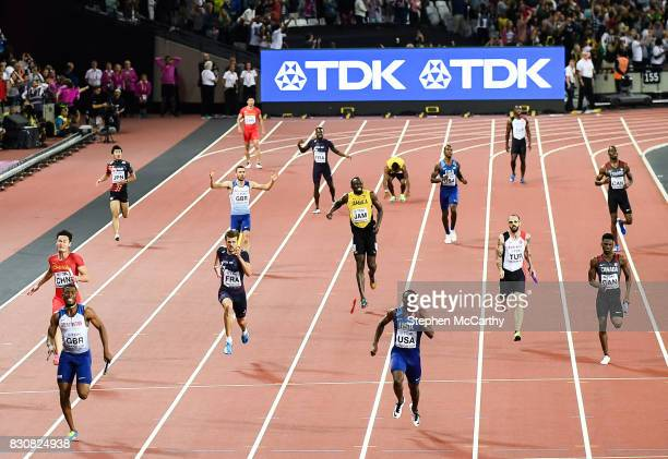 London United Kingdom 12 August 2017 Usain Bolt running the anchor leg for his Jamaica team pulls up with an injury during the final of the Men's...