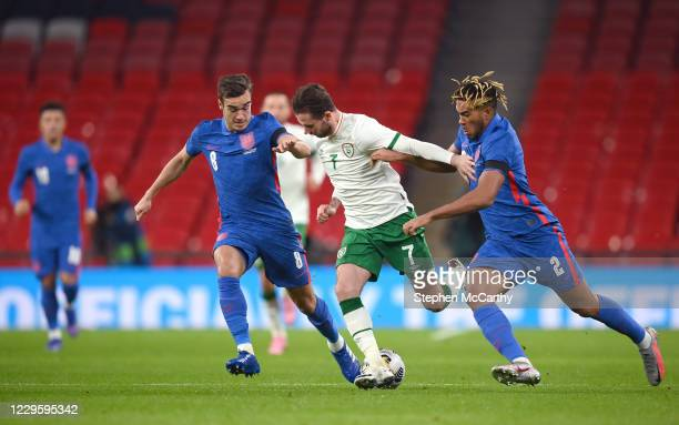 London , United Kingdom - 12 November 2020; Alan Browne of Republic of Ireland in action against Harry Winks, left, and Reece James of England during...