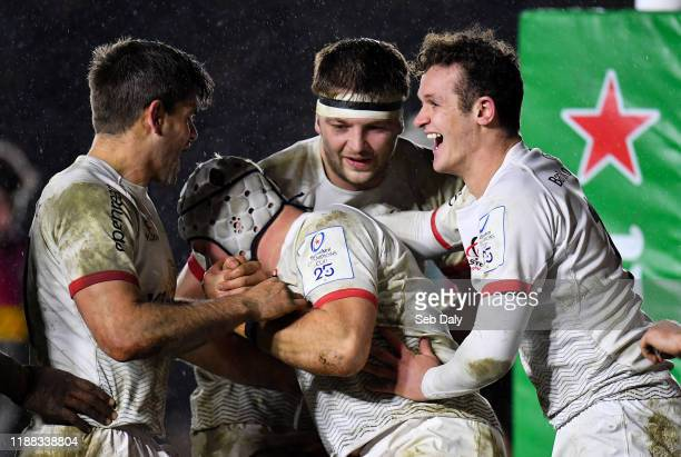 London United Kingdom 13 December 2019 Luke Marshall of Ulster centre is congratulated by teammates from left Louis Ludik Iain Henderson and Billy...