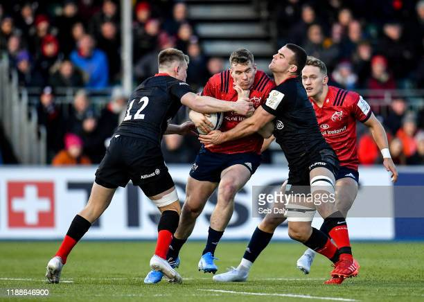 London United Kingdom 14 December 2019 Chris Farrell of Munster is tackled by Nick Tompkins left and Ben Earl of Saracens during the Heineken...