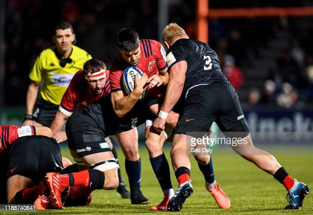 London United Kingdom 14 December 2019 Conor Murray of Munster is tackled by Ben Earl left and Vincent Koch of Saracens during the Heineken Champions...