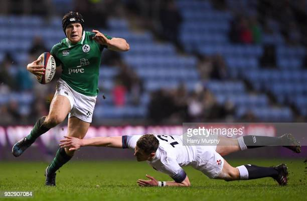 London United Kingdom 16 March 2018 Angus Curtis of Ireland avoids a tackle from Fraser Dingwall of England during the U20 Six Nations Rugby...