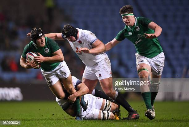 London United Kingdom 16 March 2018 Angus Curtis of Ireland is tackled by Tom Hardwick of England during the U20 Six Nations Rugby Championship match...