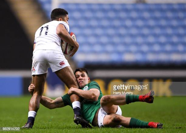 London United Kingdom 16 March 2018 Ben Loader of England is tackled by James Hume of Ireland during the U20 Six Nations Rugby Championship match...