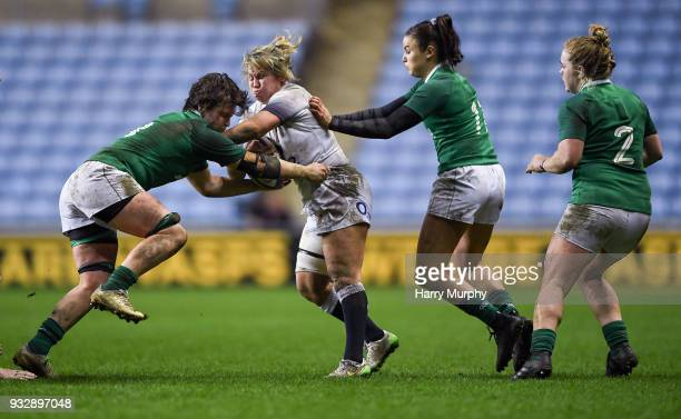 London United Kingdom 16 March 2018 Marlie Packer of England is tackled by Ciara Griffin left and Louise Galvin of Ireland during the Women's Six...