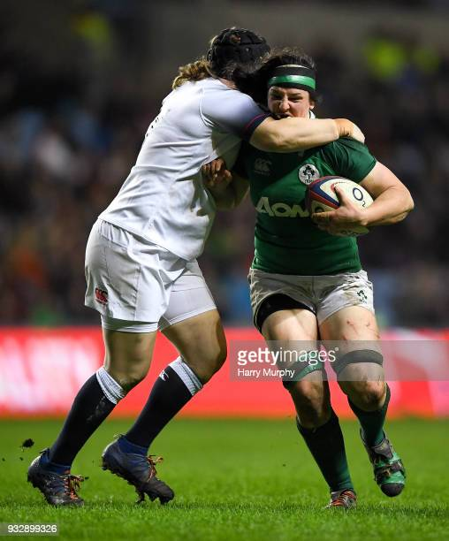 Paula Fitzpatrick of Ireland is tackled by Rochelle Clark of England during the Women's Six Nations Rugby Championship match between England and...