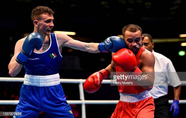 London United Kingdom 16 March 2020 Brendan Irvine of Ireland left and Istvan Szaka of Hungary during their Men's Flyweight 52KG Preliminary round...