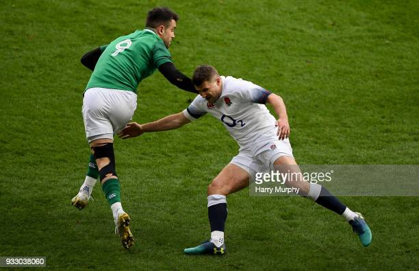 London United Kingdom 17 March 2018 Conor Murray of Ireland is tackled by Richard Wigglesworth of England during the NatWest Six Nations Rugby...